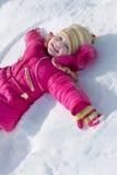 Fille sur la neige de fond Photo libre de droits