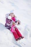 Fille sur la neige de fond Image stock