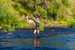 Fille sur la pêche Photographie stock libre de droits