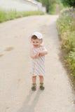 Fille sur la route Photos libres de droits