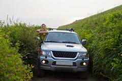 Fille sur la voiture Photo libre de droits