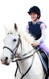 Fille sur le cheval blanc, fond blanc Image libre de droits