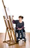 Fille sur le fauteuil roulant Photos libres de droits