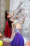 Fille sur le fond du style d'Arabe de tapis Images stock
