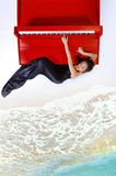 Fille sur le piano Photo libre de droits