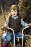Fille sur le tricycle Photo libre de droits