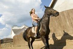 fille sur un cheval Photo stock