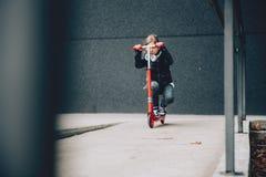 Fille sur un scooter Photos libres de droits