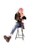Fille sur une chaise Image libre de droits