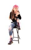 Fille sur une chaise Photos libres de droits