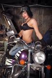 Fille sur une moto Image stock