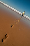 Fille sur une plage Image stock