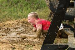 Fille surmontant des obstacles Photos stock