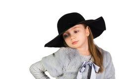 Fille tenant le chapeau et les grands yeux Photo libre de droits