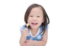 Fille tenant une lucette au-dessus de blanc Image stock