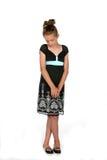 Fille timide dans la robe noire photographie stock libre de droits