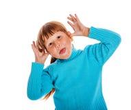 Fille tirant des visages photographie stock libre de droits