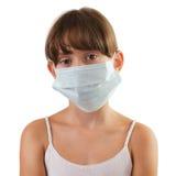 Fille triste dans un masque médical Photos stock