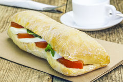 Filled baguette with mozzarella cheese on table Royalty Free Stock Photo