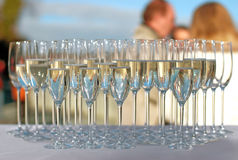 Filled champagne glasses on a cocktail party Stock Photo