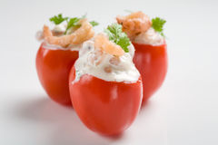 Filled cherry tomatoes. Small cherry tomatoes filled with shrimp cocktail Stock Photography