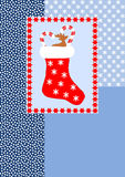 Filled christmas stocking on different pattern Royalty Free Stock Photography