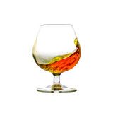 A filled cognac snifter with moving liquid royalty free stock image