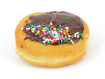 Filled donut with chocolate icing and sprinkles Royalty Free Stock Photos