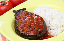 Filled eggplant with meat and vegetable. In tomato sauce with rice Royalty Free Stock Photo