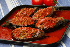 Filled eggplants with meat and vegetable. In tomato sauce Stock Photo