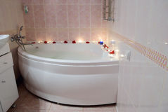 Filled with foam bath, rose petals and candles Royalty Free Stock Photo