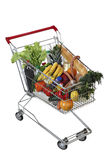 Filled foodstuffs shopping cart isolated on white background, no stock images
