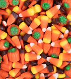 Filled frame of autumn holiday candy corn and pumpkin shapes Royalty Free Stock Photos