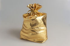 Filled gold sack on gray Stock Images