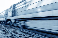 Filled with goods train, high-speed driving. Stock Images
