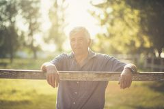 Filled with hope and positivity. Senior man in nature. Copy space. Close up. Looking at camera stock photos