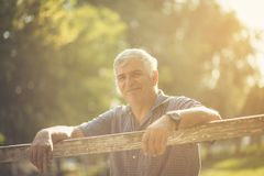 Filled with hope and positivity. Senior man in nature. Copy space. Close up. Looking at camera stock photo