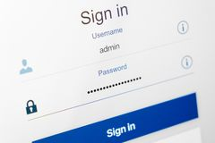 Filled login and hidden by dots password at login screen. On the website Stock Photography