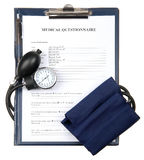 Filled in medical questionnaire with sphygmomanometer Stock Image
