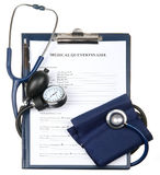Filled medical questionnaire, stethoscope and sphygmomanometer. Isolated on white background Royalty Free Stock Images