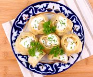 Filled mince dumplings with cream Stock Images