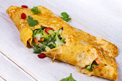 Filled Omelette with Onion, Carrot, Avocado, Cabbage Coriander, Chilli, Yoghurt. Royalty Free Stock Image