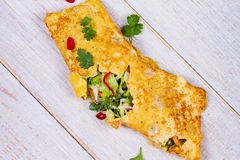 Filled Omelette with Onion, Carrot, Avocado, Cabbage Coriander, Chilli, Yoghurt. Royalty Free Stock Photography