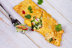 Filled Omelette with Onion, Carrot, Avocado, Cabbage Coriander, Chilli, Yoghurt. Stock Photo