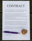 Filled paper contract. Pen and stamp on a filled contract Royalty Free Stock Photos