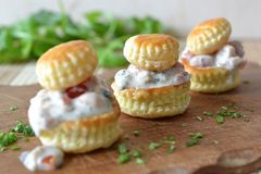 Filled pastries. Pastries filled with shrimps and tarragon mayonnaise Stock Image