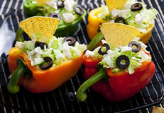 Filled peppers. Peppers filled with salad and nachos Stock Photography