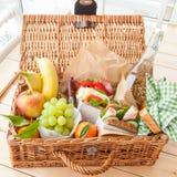 Filled picnic basket stock images
