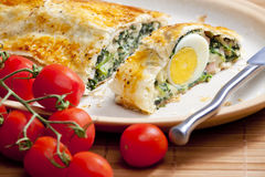 Filled puff roly-poly. Puff roly-poly filled with spinach and eggs Royalty Free Stock Image