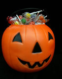 Filled pumpkin. Halloween pumpkin filled with candy Stock Images
